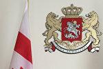 Флаг и герб Грузии.