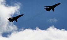 Самолеты Су-24 во время тактических учений, архивное фото
