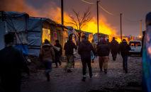 Simtiem Kalē nometnes iedzīvotāju gatavi doties uz citiem centriem Francijā. Foto no arhīva