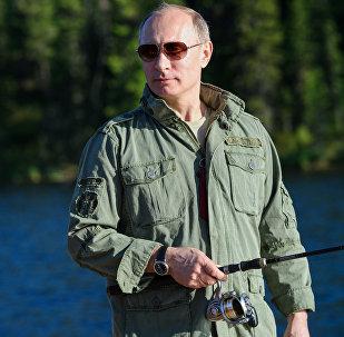 2013. gada 20. jūlijs. Krievijas prezidents Vladimirs Putins makšķerē Tivas Republikā.