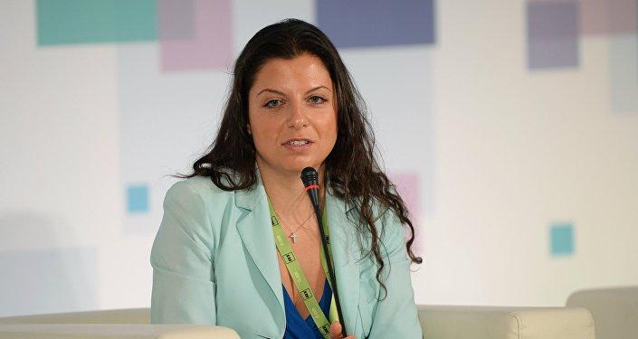 Sputnik un telekanāla RT galvenā redaktore Margarita Simoņana