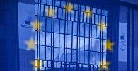 Флаг Евросоюза на фоне здания в Брюсселе