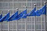 Флаги Евросоюза у здания штаб-квартиры Европейской комиссии в Брюсселе