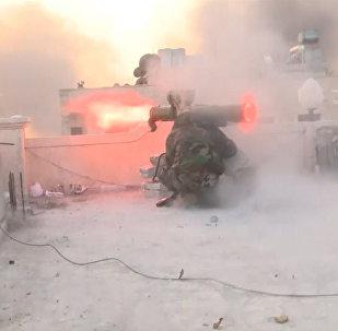 Cīņas par Alepo: granātmetēju šāvieni un dūmi virs Al Asada kvartāla