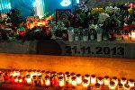 Свечи в память о жертвах трагедии в Золитуде 21 ноября 2013 года