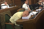 Депутат Валдис Калнозолс спит на заседании Сейма