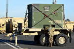 Разгрузка американской военной техники в порту Бремерхафен в Германии