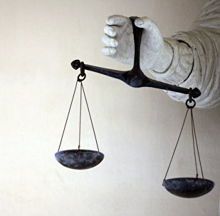 Весы правосудия в руках Фемиды, иллюстративное фото