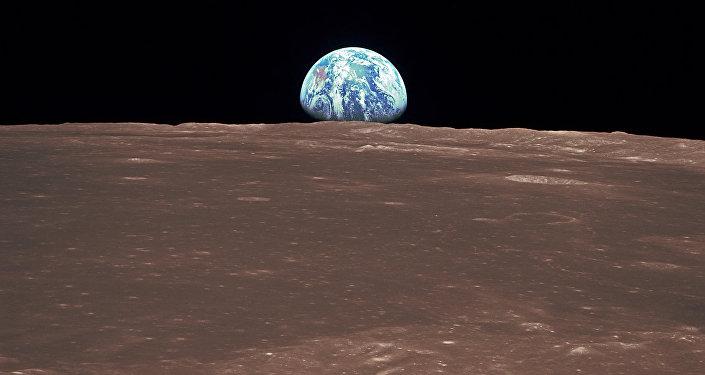 Восход Земли над лунным горизонтом, архивное фото