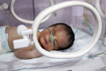 Новорожденный в родильном доме