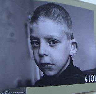 Berlīnē atklāta fotoizstāde 101 dzīvība. Mirušie Donbasa bērni