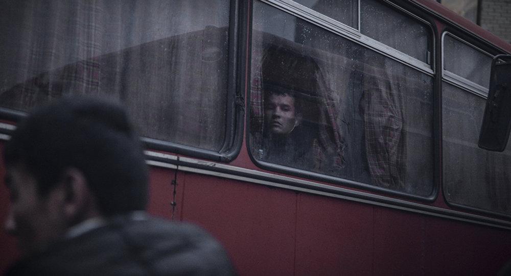 Беженцы в автобусе. Архивное фото