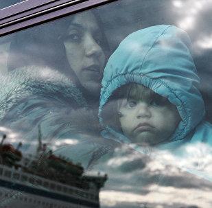Bēgļi autobusā. Foto no arhīva