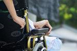 Пациент в кресле каталке