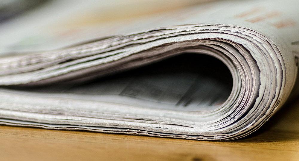 Газета на столе