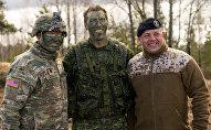 Американский, канадский и латвийский военные на международных учениях Summer Shield XIV