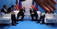 Krievijas prezidents Vladimirs Putins un ASV vadītājs Donalds Tramps G20 samitā Hamburgā. Foto no arhīva