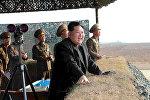 Лидер Северной Кореи Ким Чен Ын во время запуска ракеты
