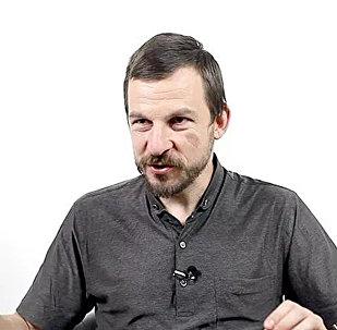 Доцент Международного института экономики и финансов Алексей Белянин