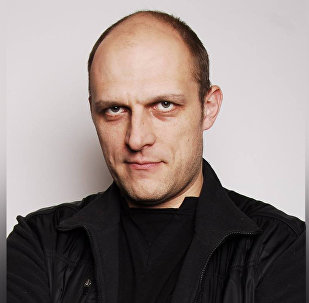 Спортивный журналист Алексей Осин