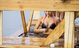 В Риге прошел чин Великого освящения вод Даугавы и крещенские купания