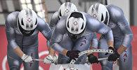 Команда Оскарса Мелбардиса во время соревнований четверок по бобслею среди мужчин на XXIII зимних Олимпийских играх в Пхенчхане