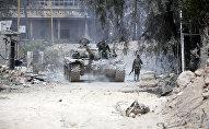 Sīrijas armijas karavīri Dumas austrumu nomalē. 2018. gada 8. aprīlis
