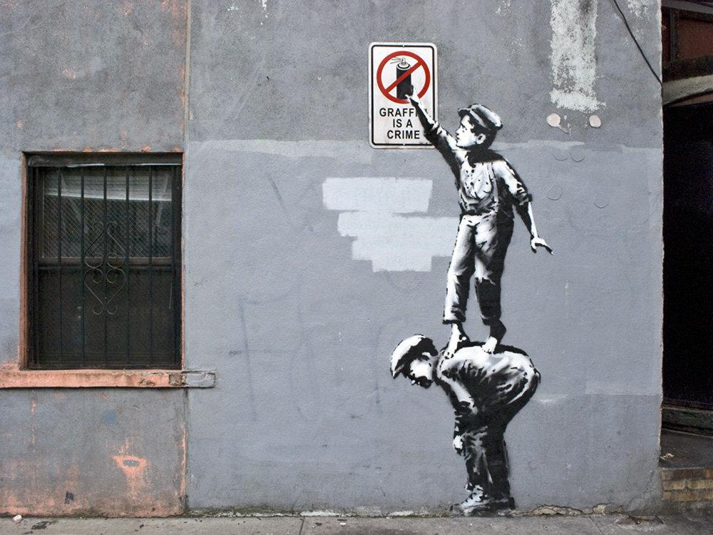 Benksija darbs  Better out then in ietvaros. Plakāts tika nozagts, bet grafiti – aizkrāsots